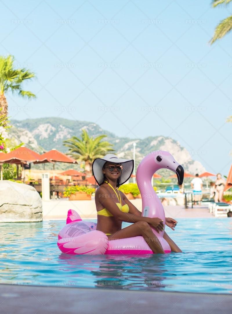 Girl On Inflatable Flamingo: Stock Photos
