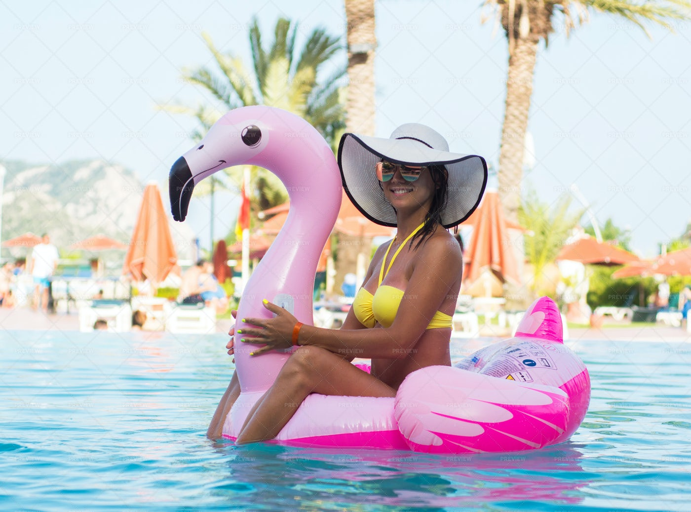 Woman Sitting On Inflatable: Stock Photos