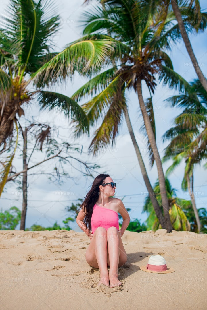 Sitting On Beach With Palm Trees: Stock Photos