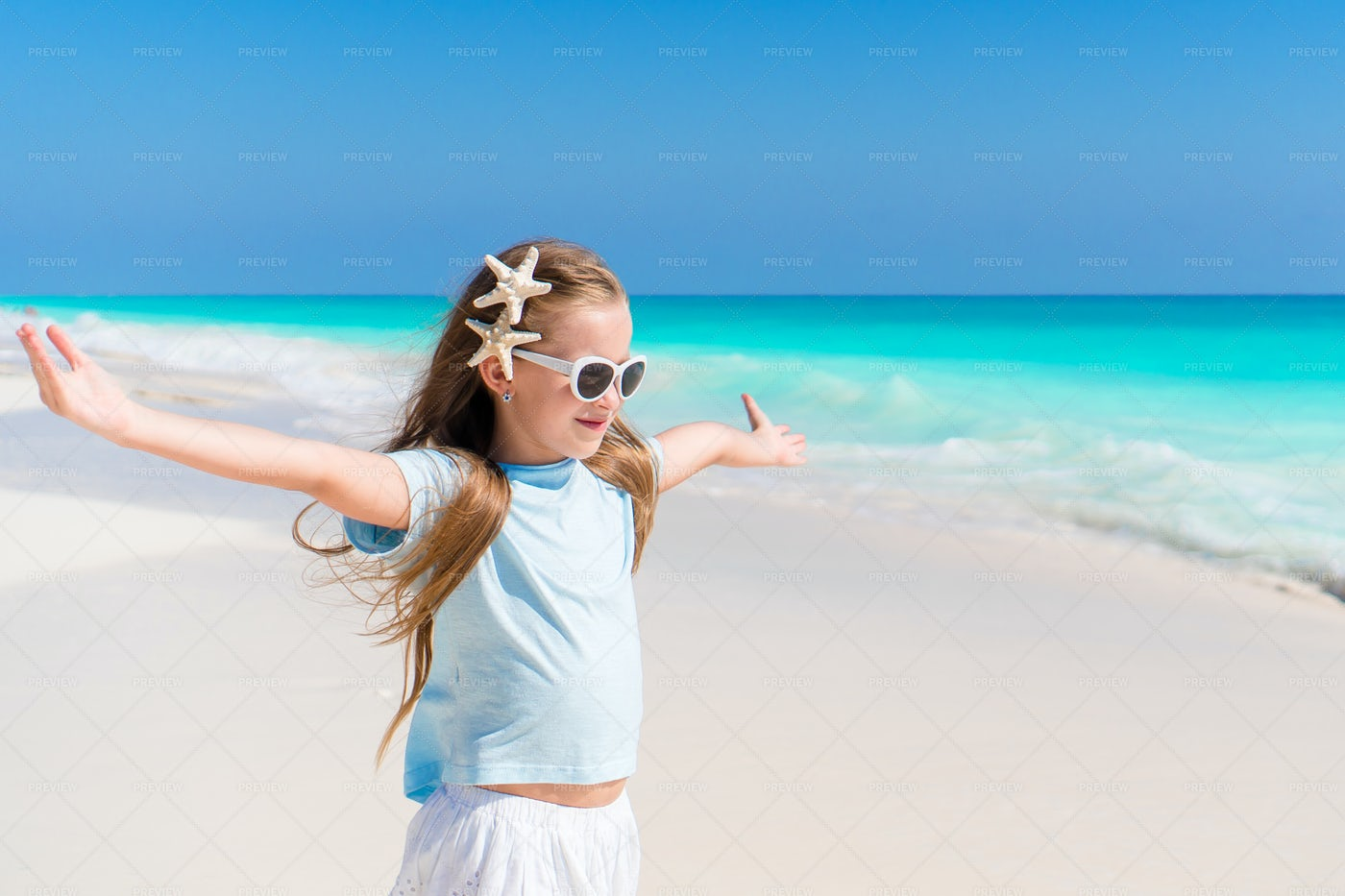 Girl With Starfish In Her Hair: Stock Photos