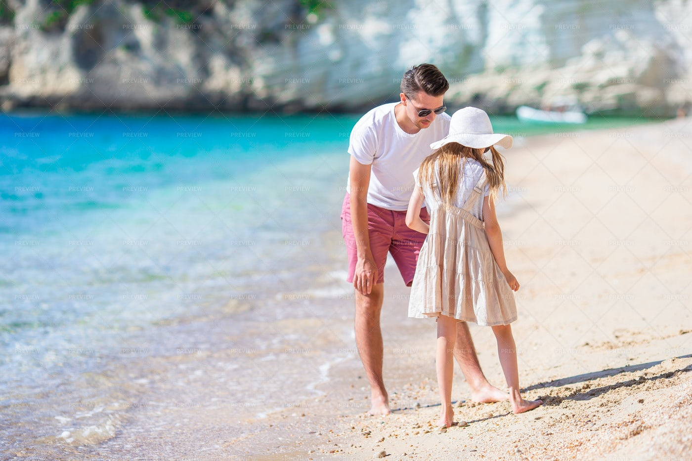 Little Girl And Happy Dad At The Beach: Stock Photos