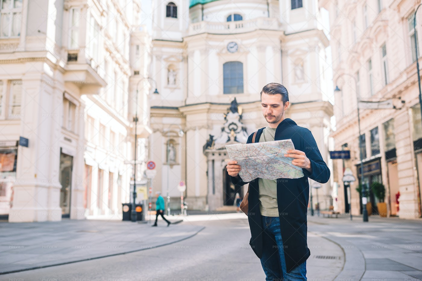 Tourist Man With A Map And Backpack: Stock Photos