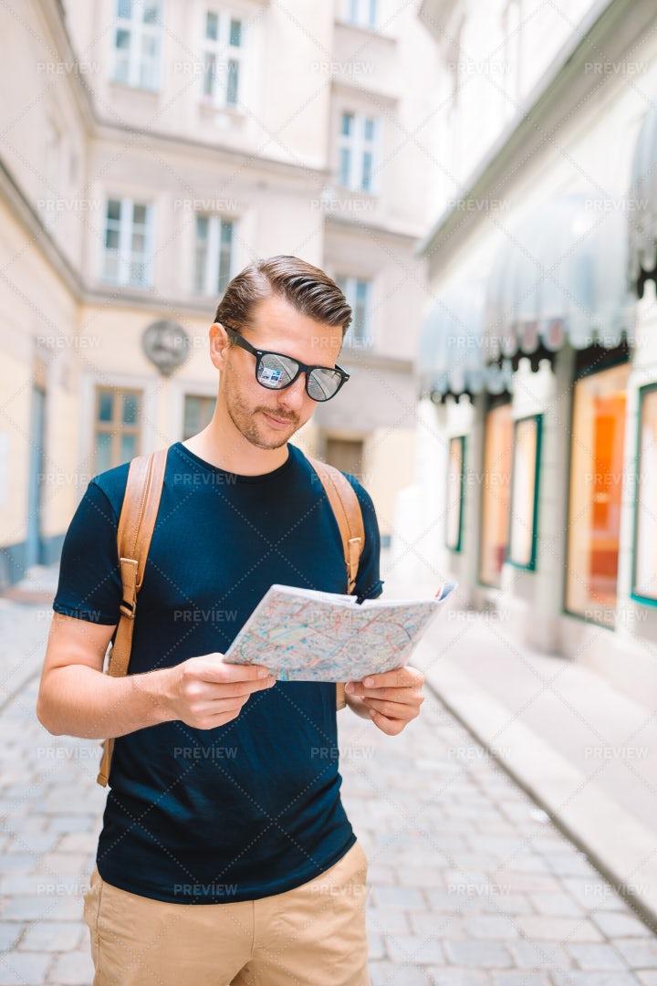 Tourist Man Reading A Map: Stock Photos