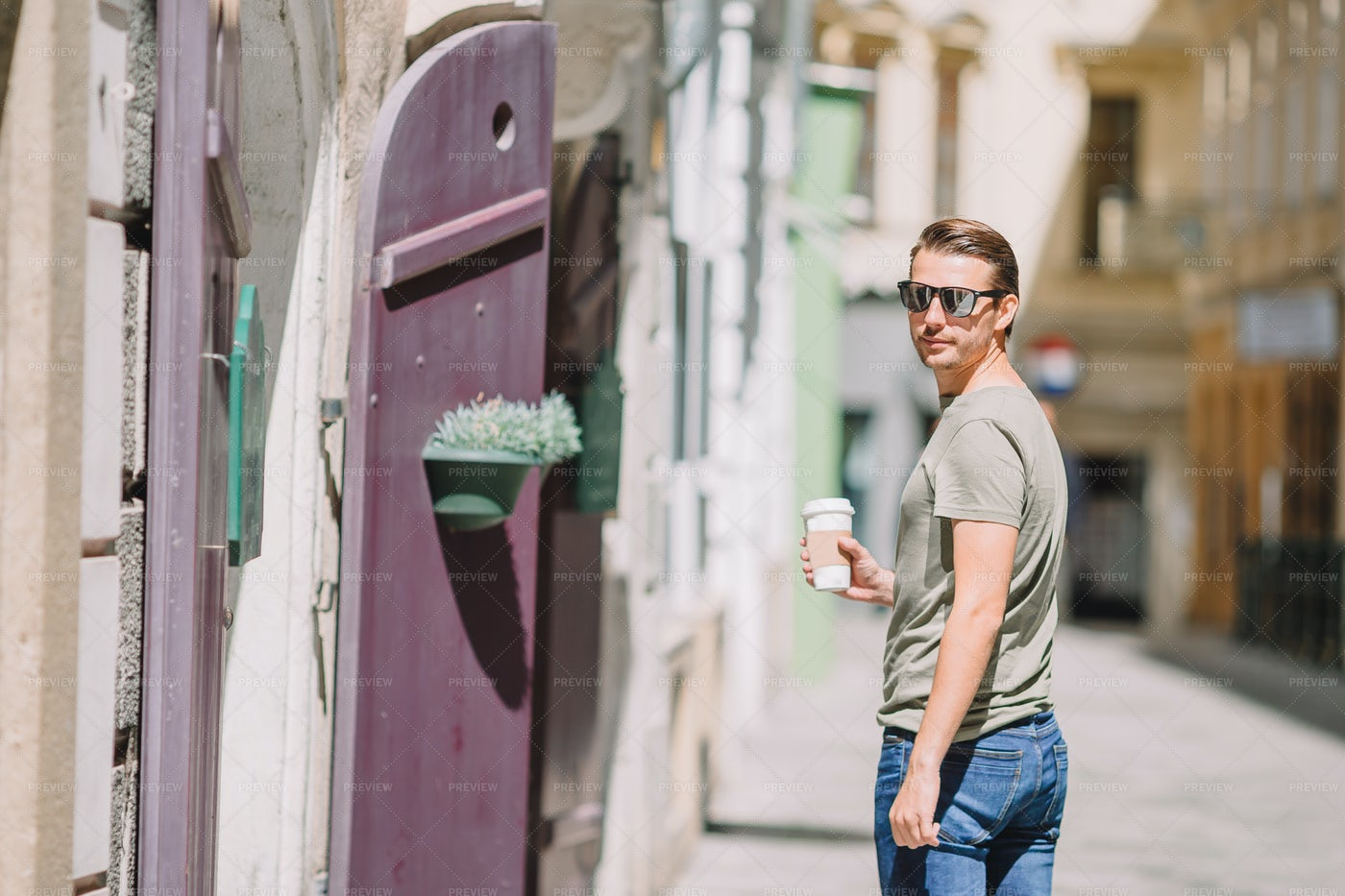 Man With Coffee Looks Back: Stock Photos