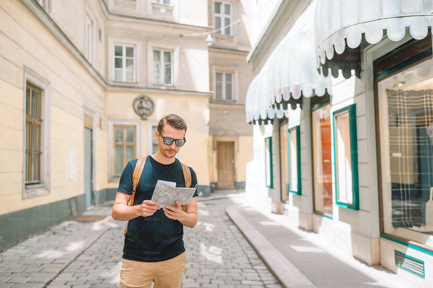 Tourist With A Map And A Backpack: Stock Photos