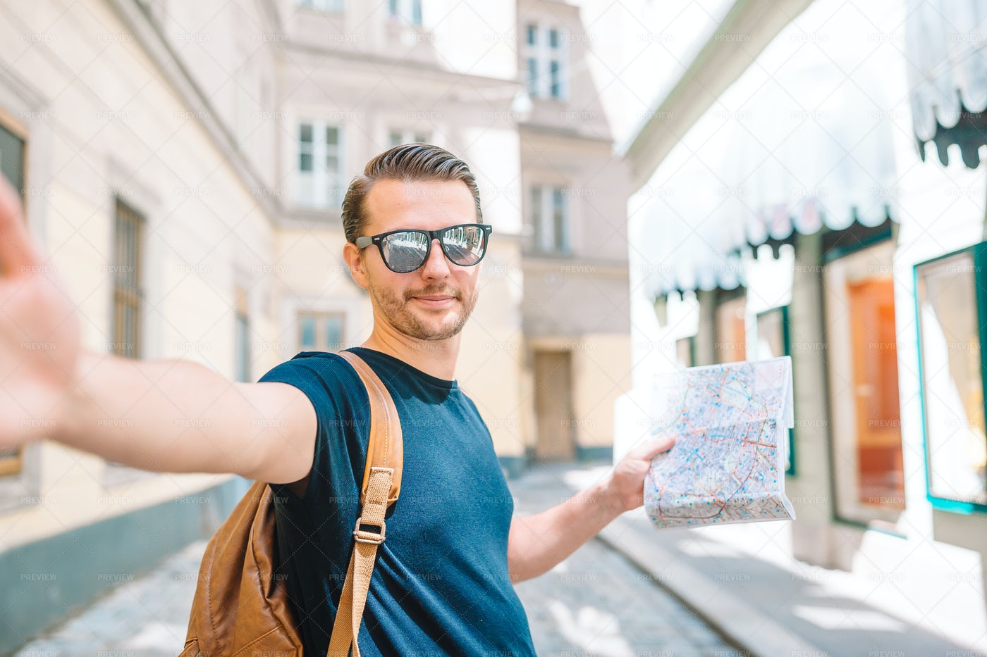 Tourist Holds Map: Stock Photos