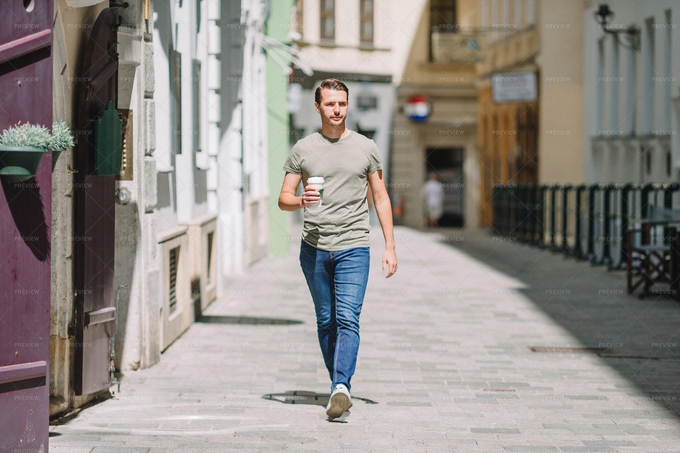 Man Walking With Coffee: Stock Photos