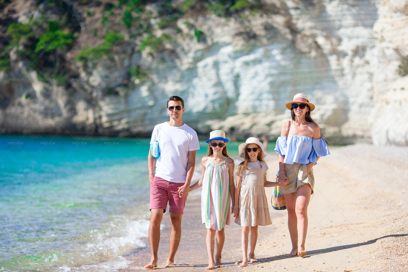 Walking Together On The Beach: Stock Photos