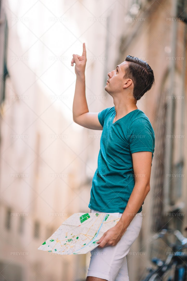 Pointing Upwards In Alley: Stock Photos