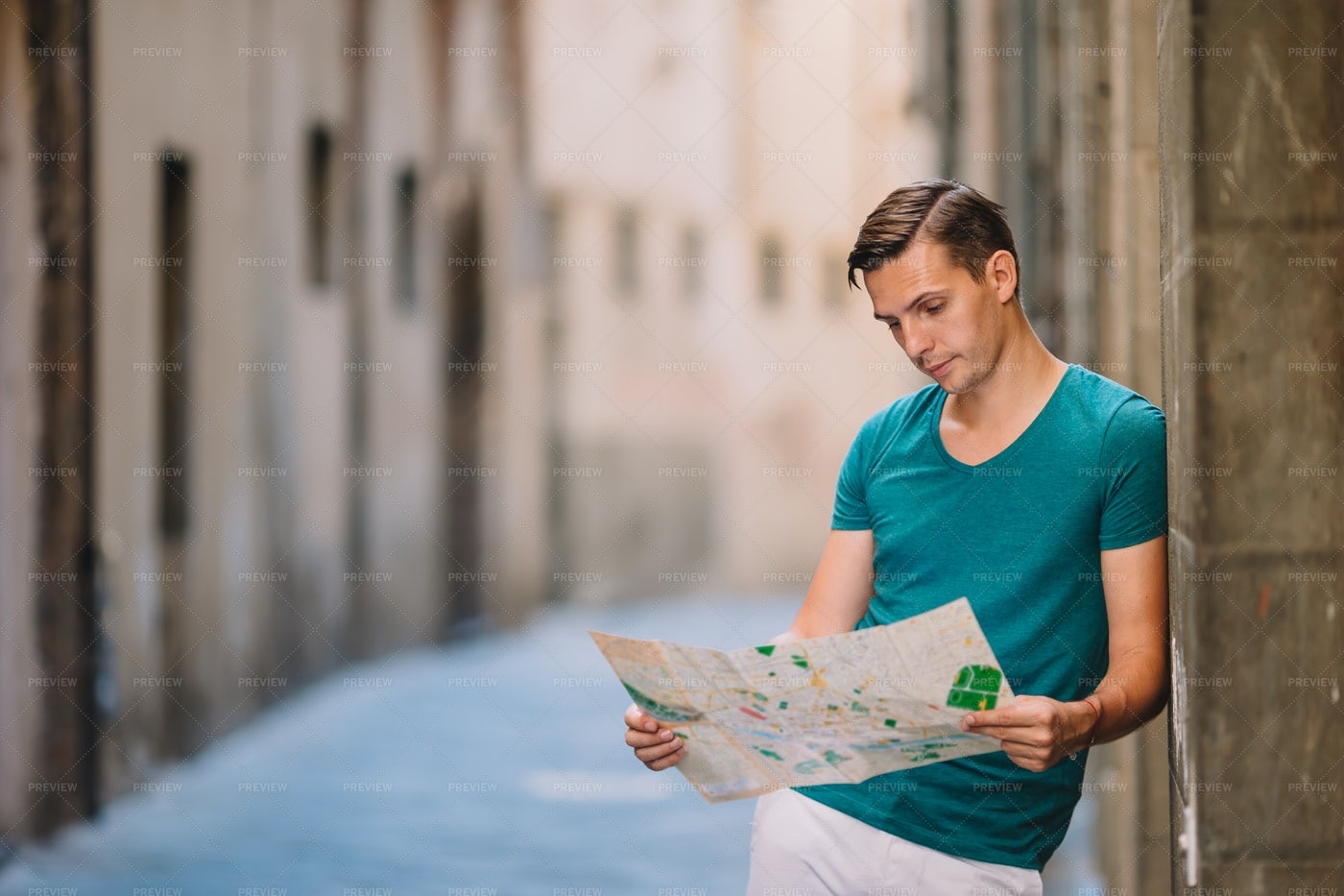 Reading Map During Travels: Stock Photos