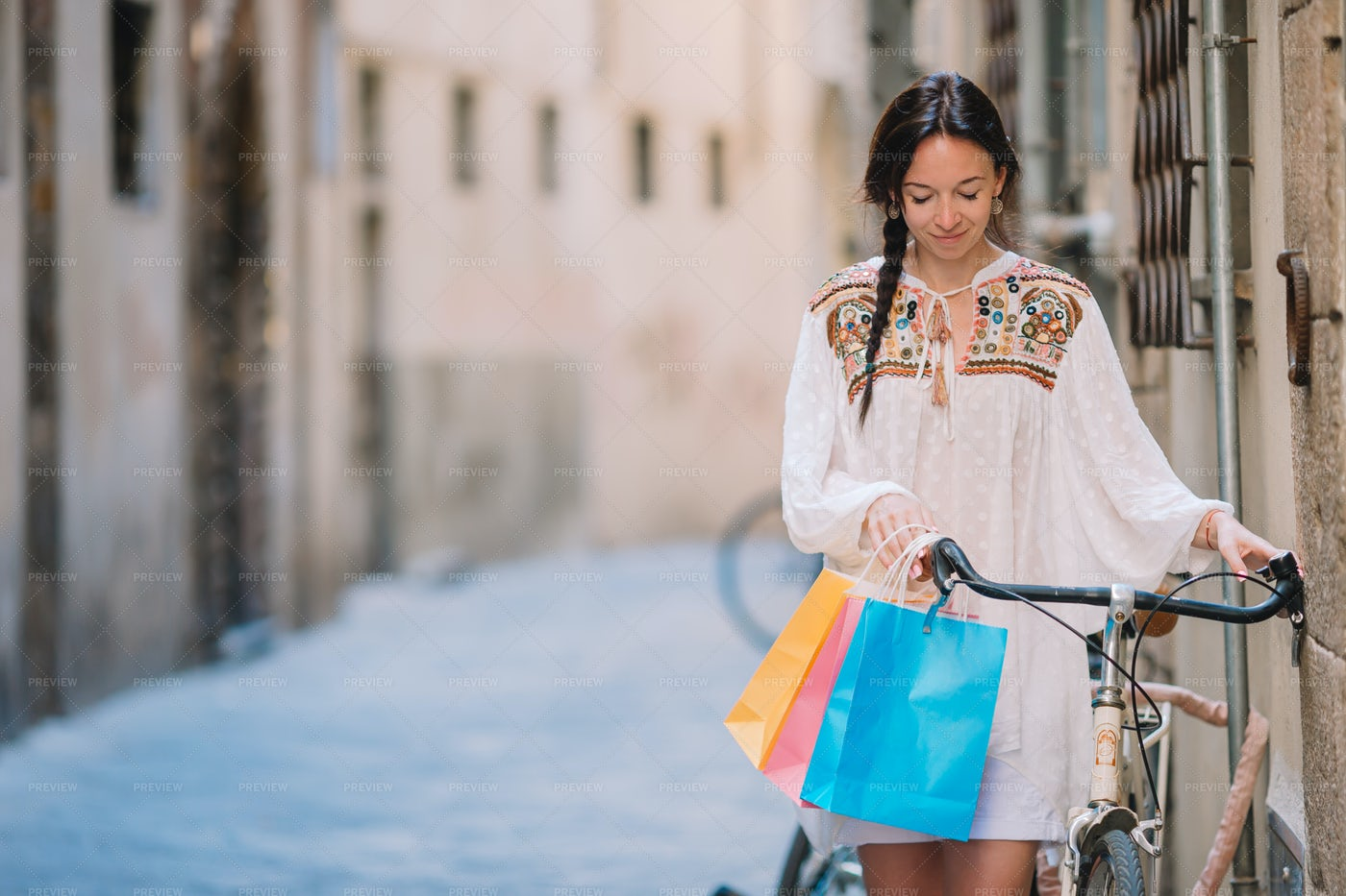 Woman With Bike And Bags: Stock Photos