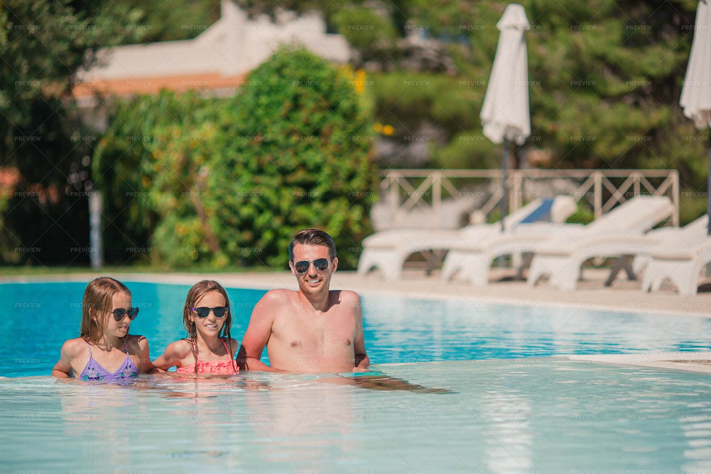 Family In Outdoor Resort Pool: Stock Photos