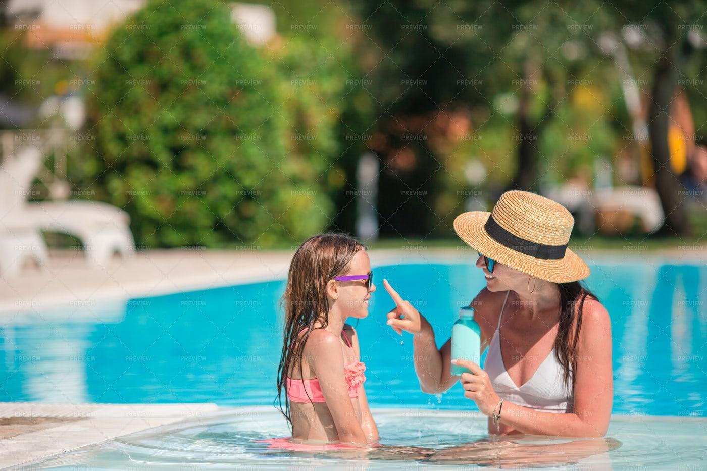 Rubbing Sunscreen On Nose: Stock Photos