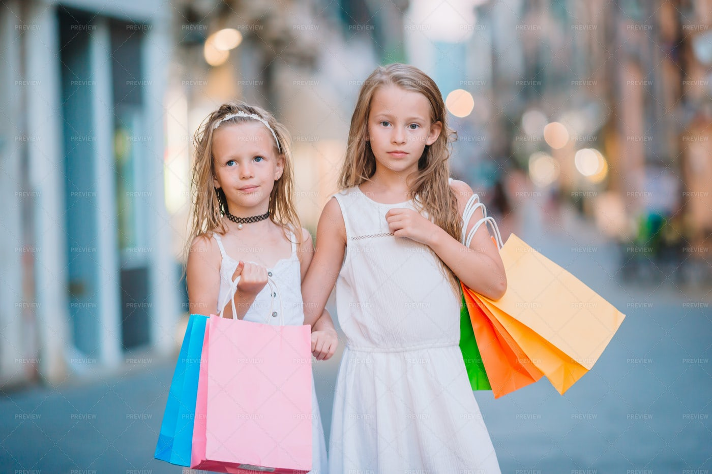 Little Girls With Shopping Bags: Stock Photos