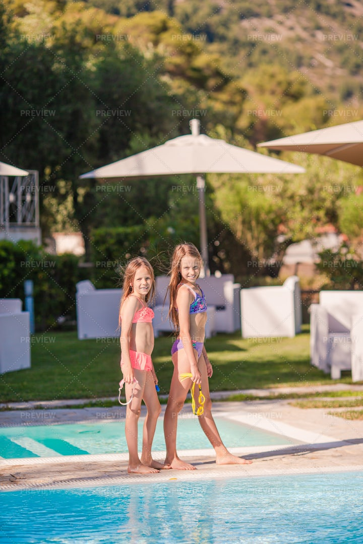 Sisters By The Pool: Stock Photos