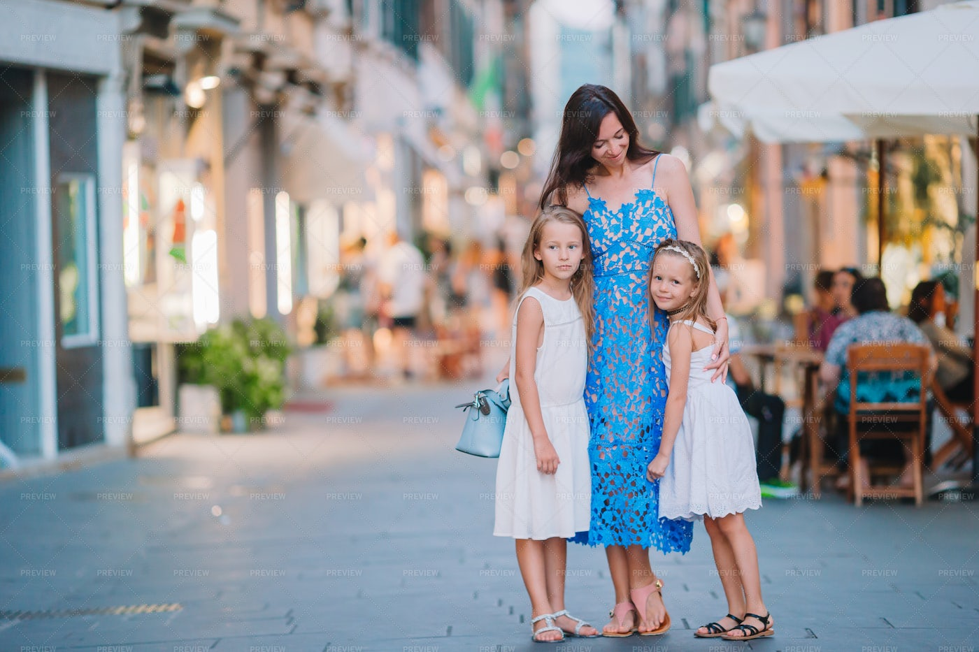 Family By The Restaurants: Stock Photos