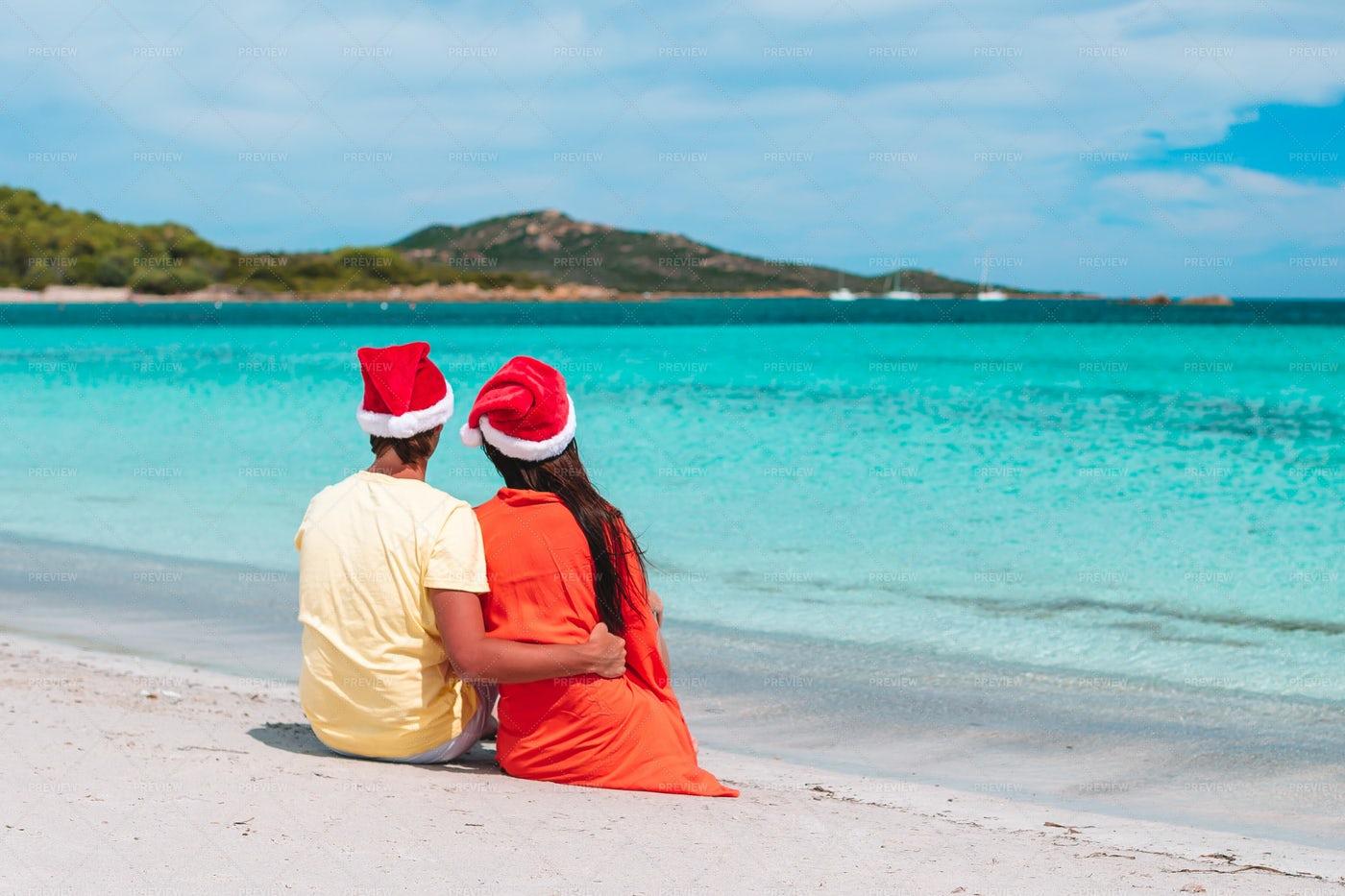 Couple Celebrate Christmas On Beach: Stock Photos