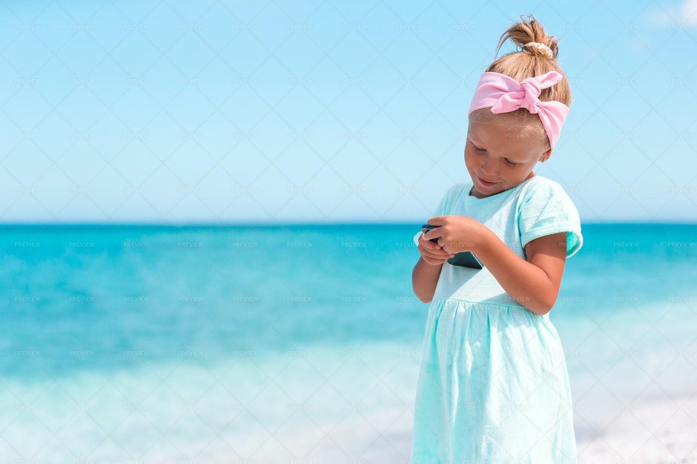 Smartphone On The Beach: Stock Photos