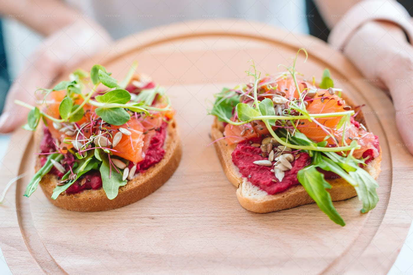 Red Hummus And Salmon On Bread: Stock Photos