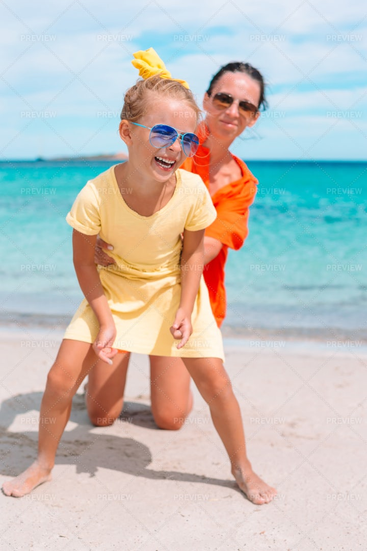 Playing With Mom On The Beach: Stock Photos