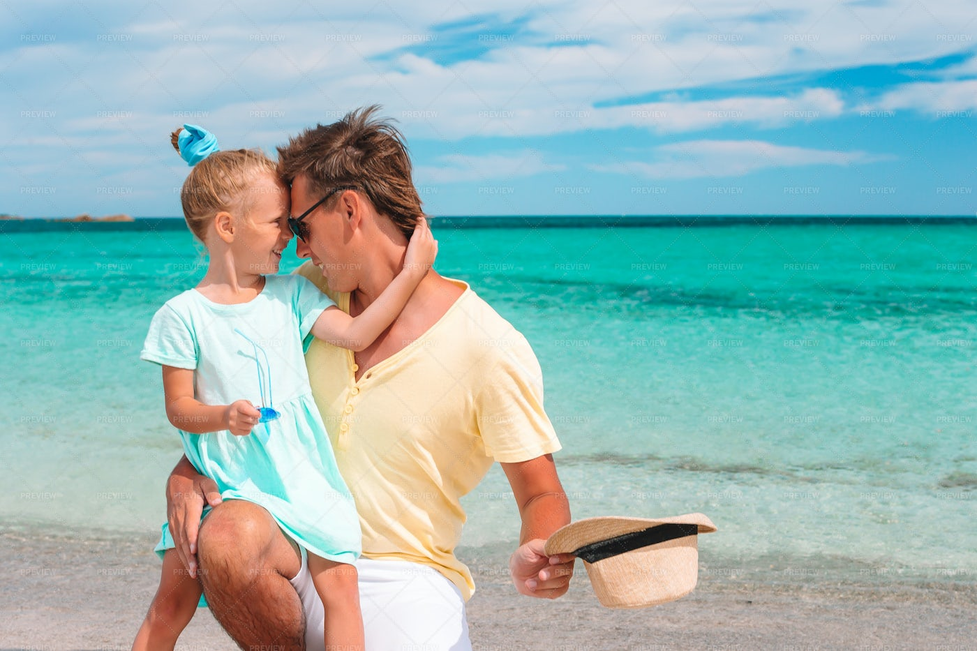 Affectionate Kid With Dad On Beach: Stock Photos