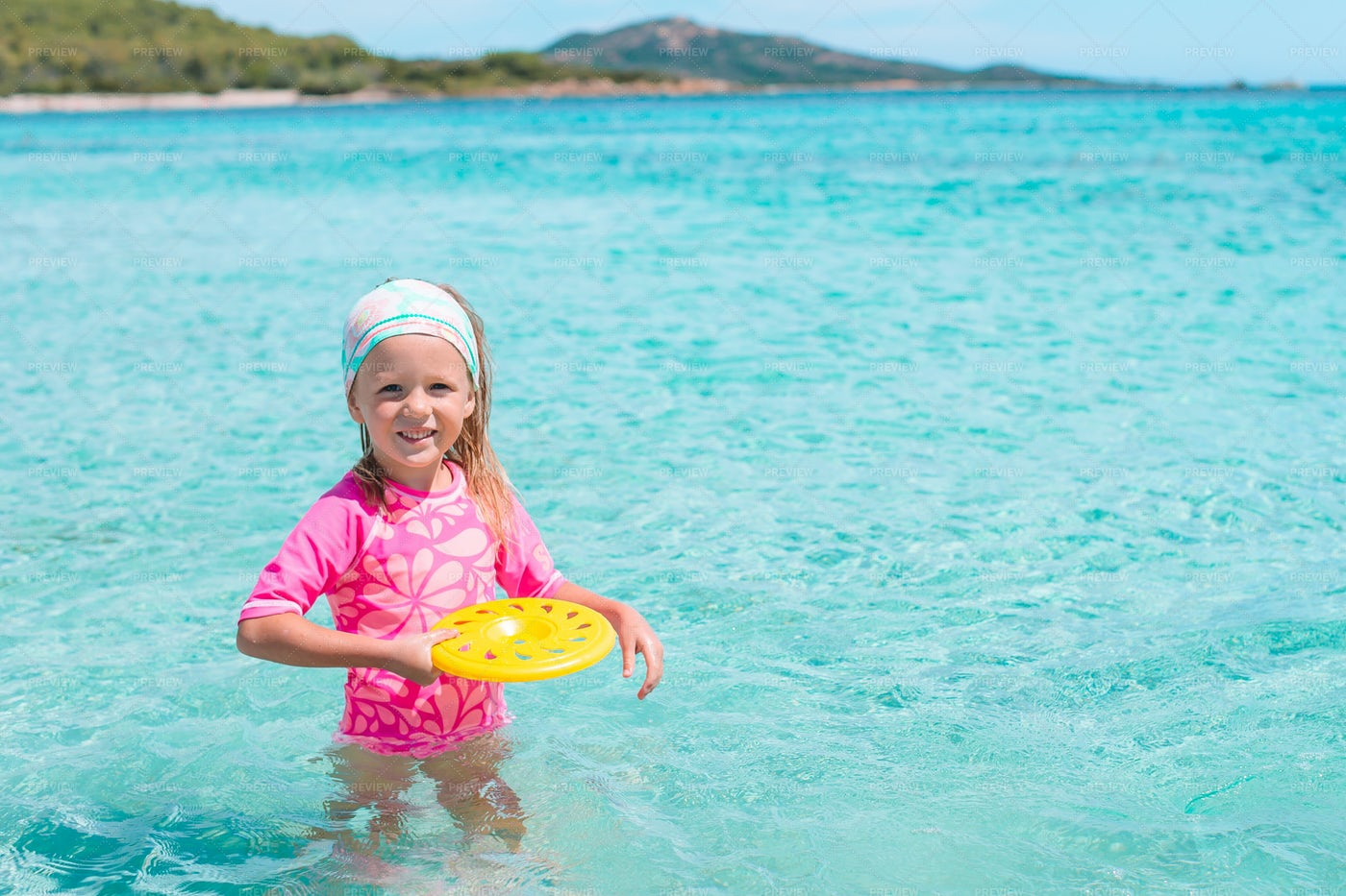Child Throwing Disc On A Beach: Stock Photos