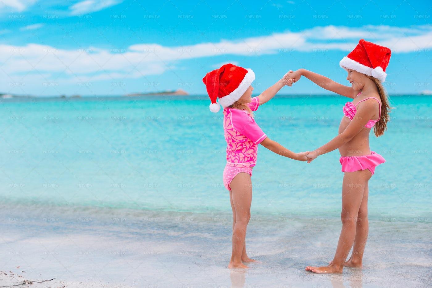 Christmas Hats On The Beach: Stock Photos