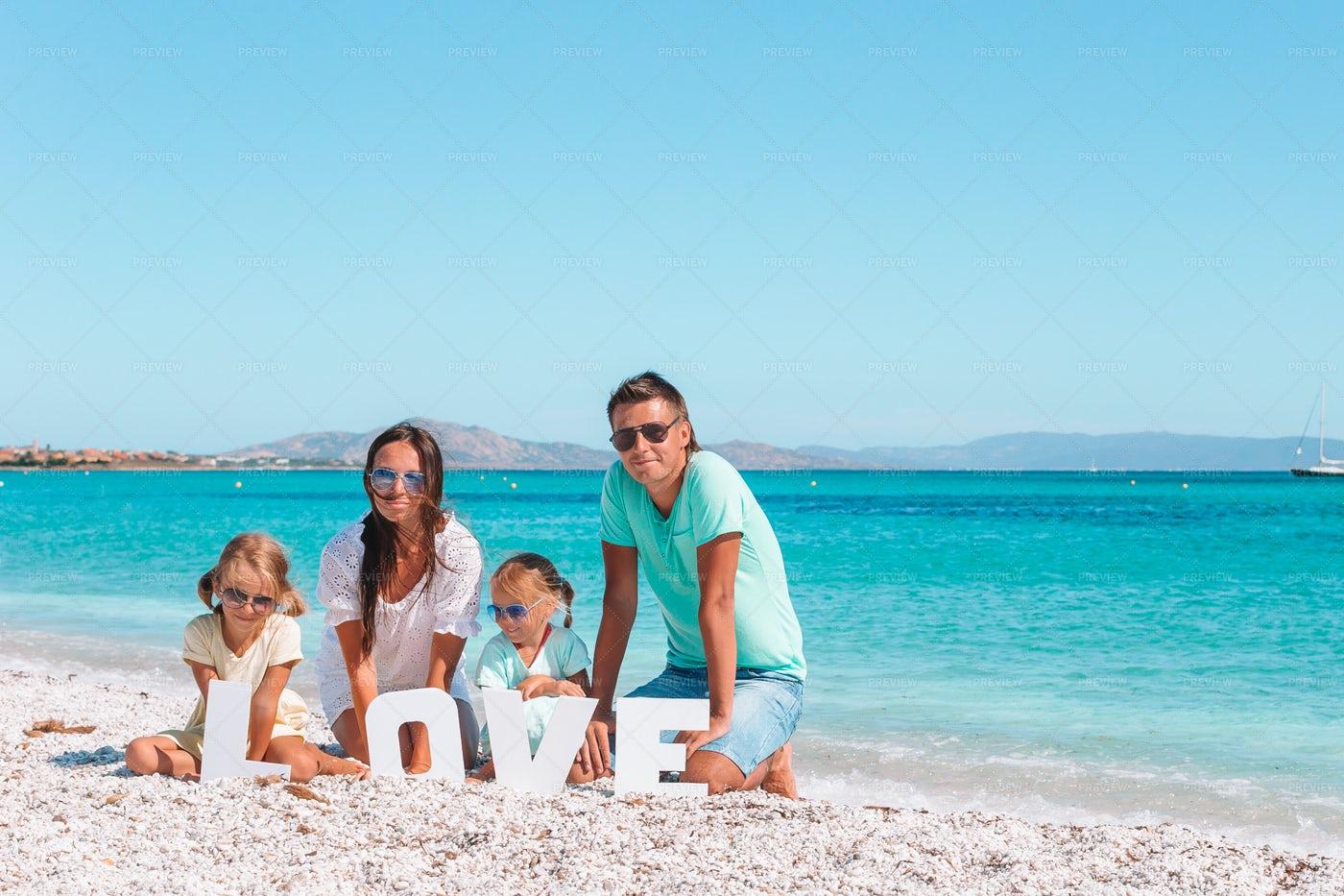 Family With Love Sign On Beach: Stock Photos