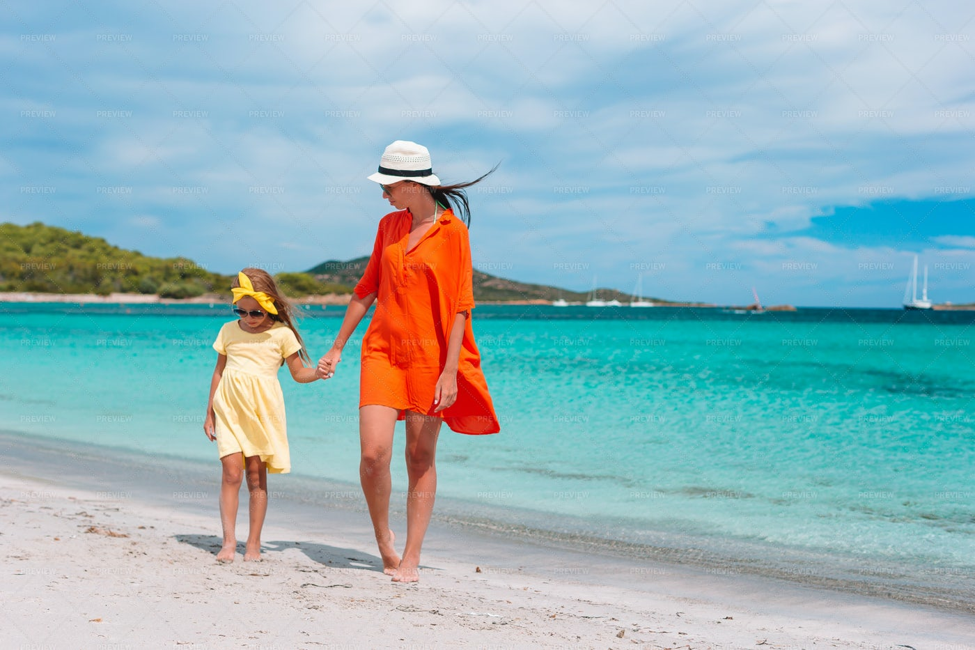 Walking With Mom On Beach: Stock Photos