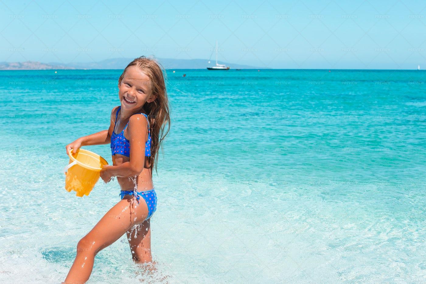 Kid Carrying Water Bucket: Stock Photos