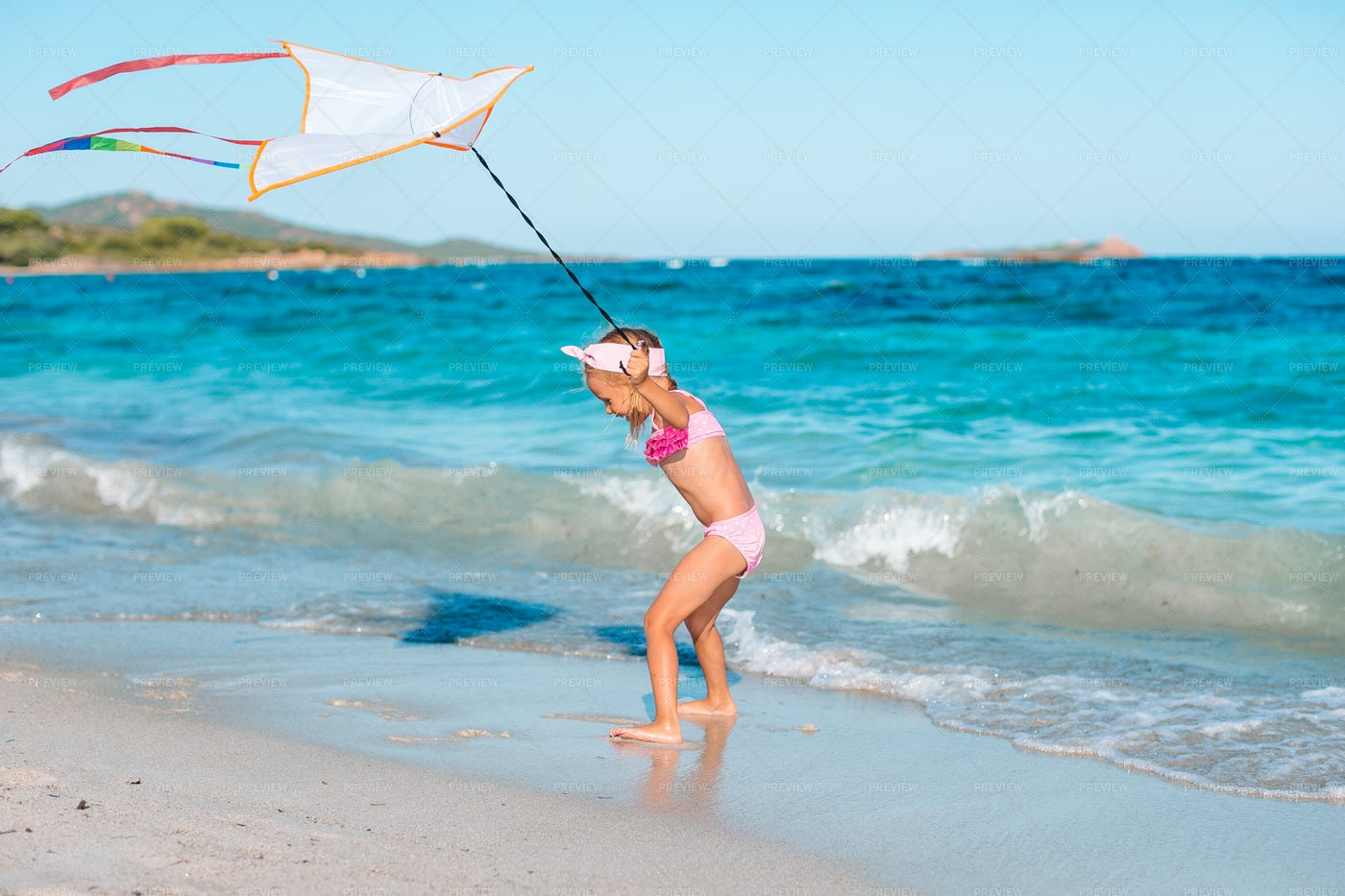 Pulling A Kite On The Beach: Stock Photos