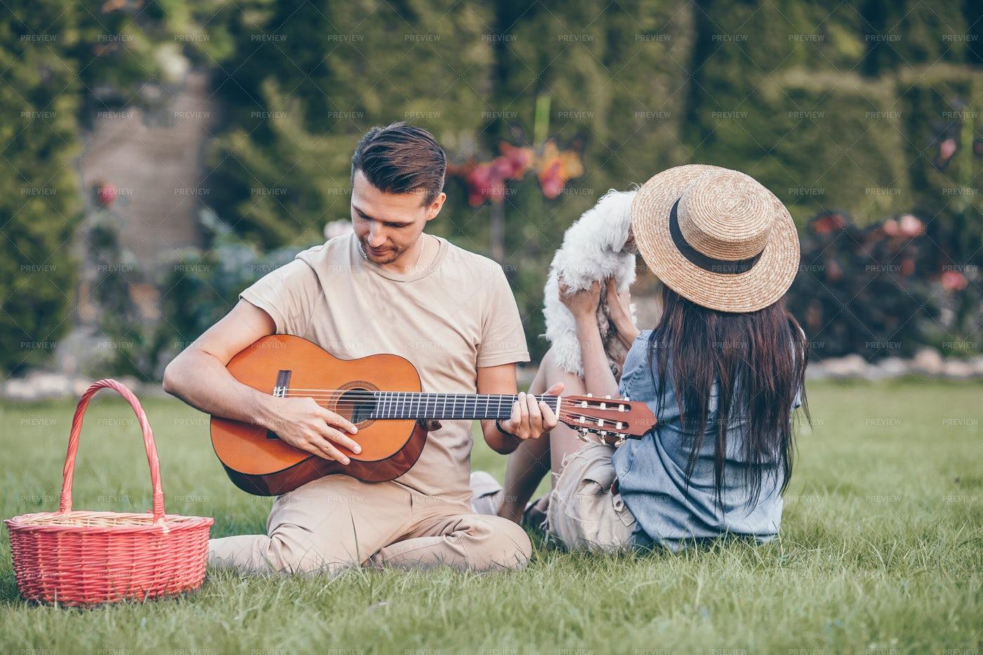 Serenade During Summer Picnic: Stock Photos