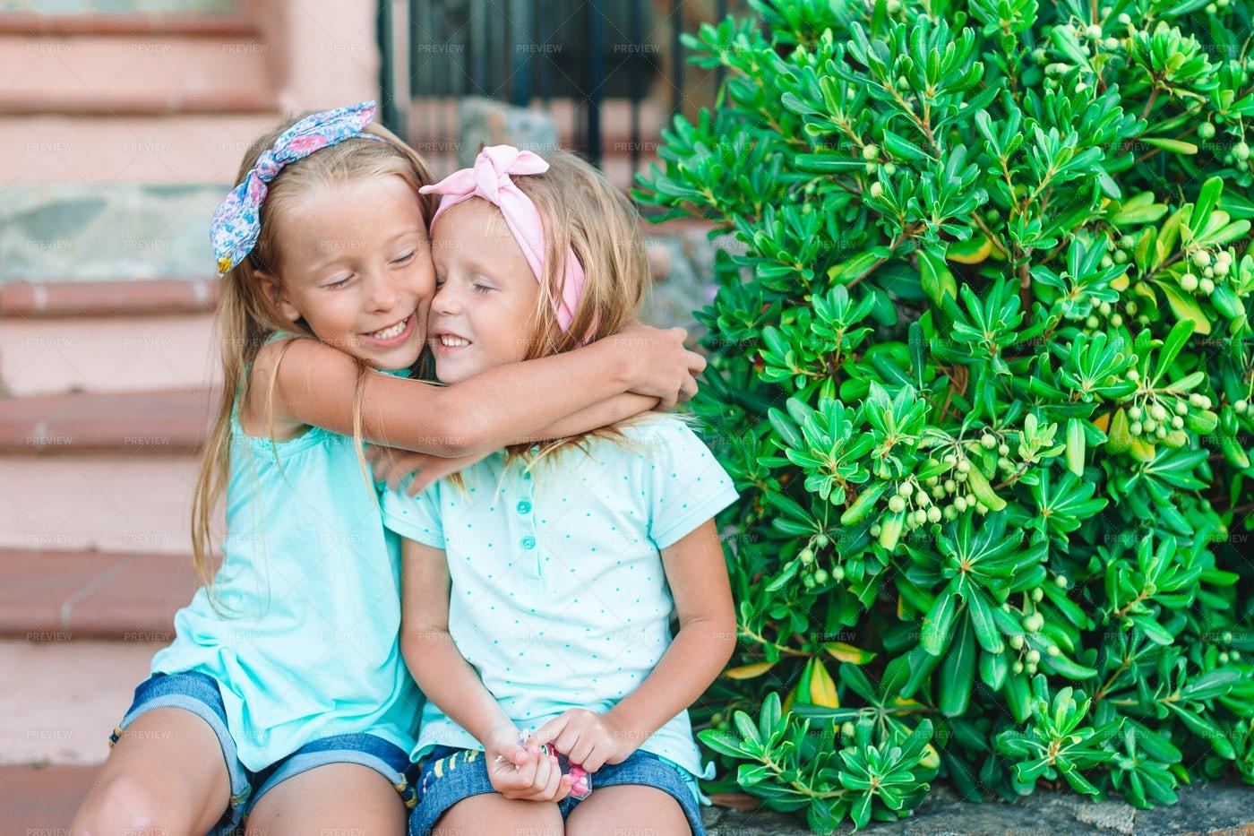 Embracing Sisters: Stock Photos