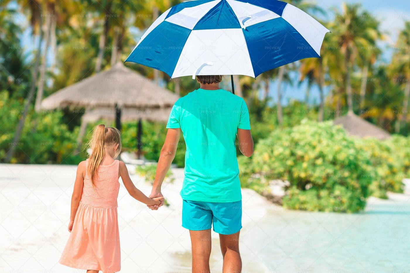 At The Beach With An Umbrella: Stock Photos