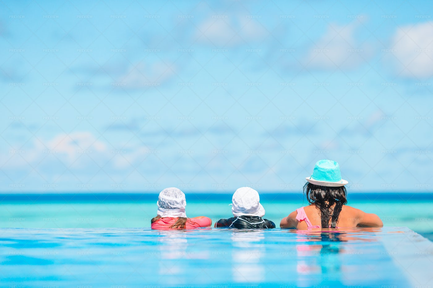 Mother And Kids At Infinity Pool: Stock Photos