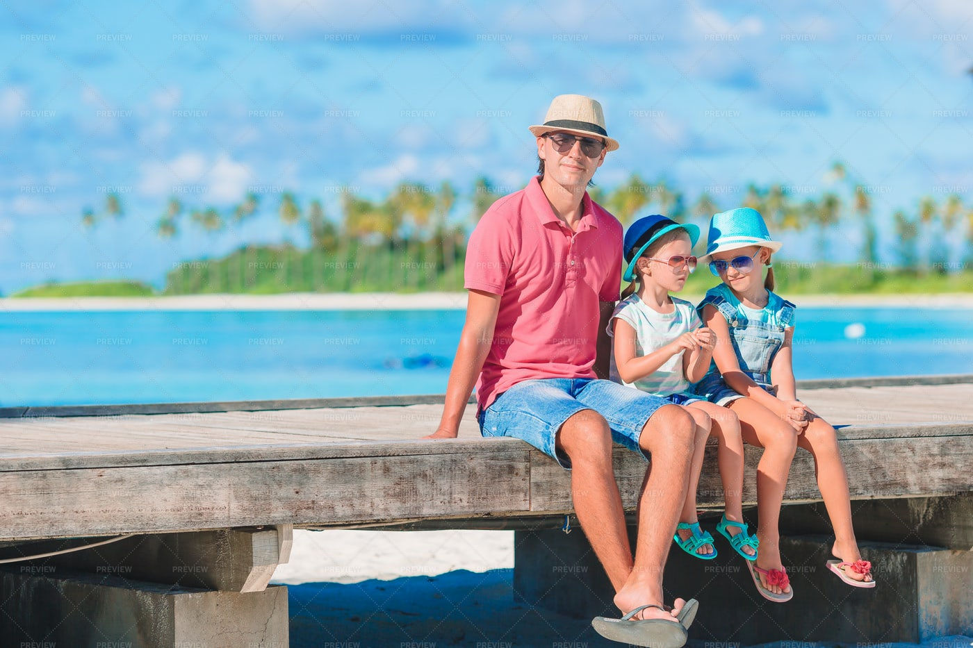 Family Sits On Pier: Stock Photos