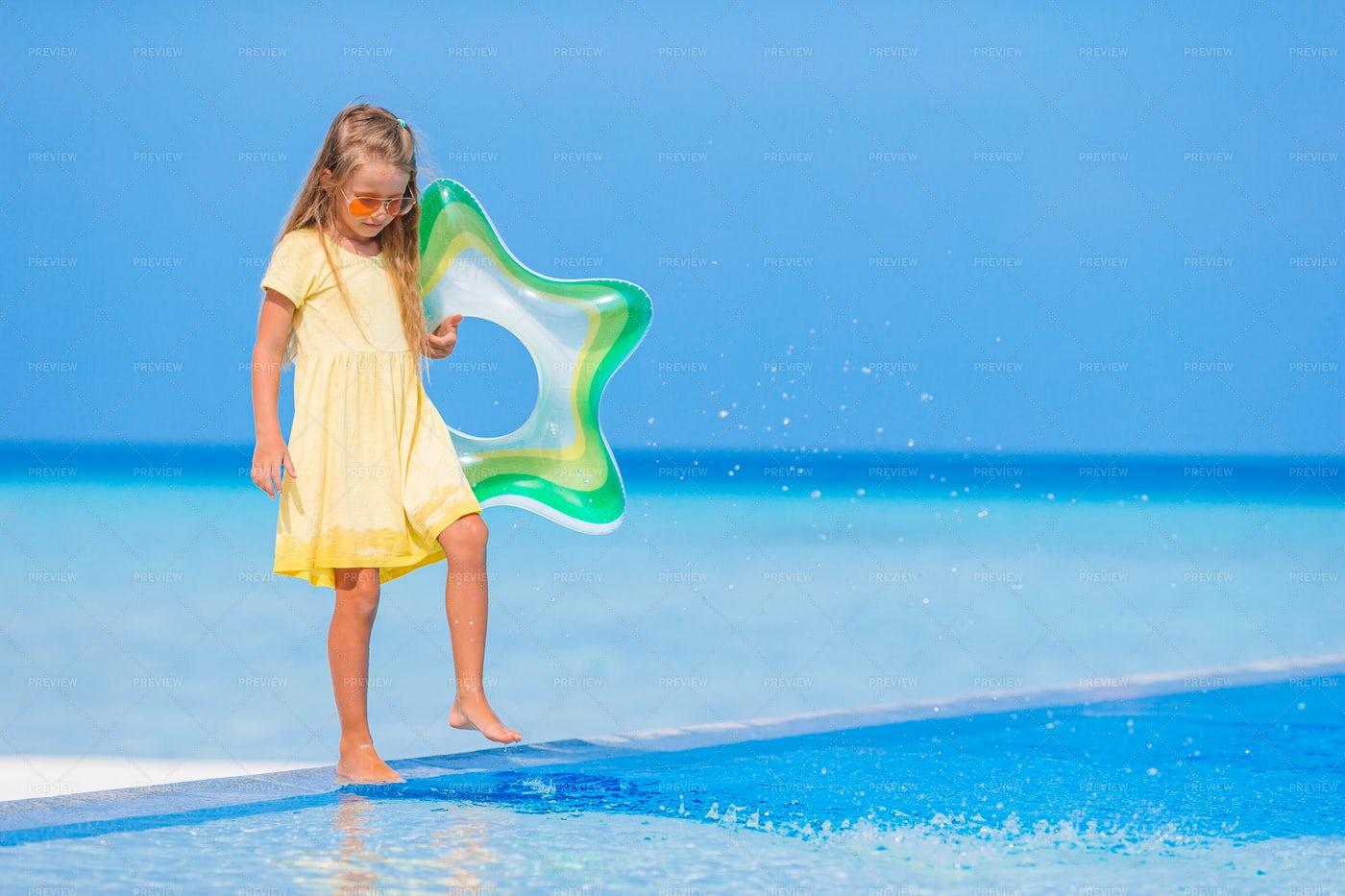 Child Holding Pool Float: Stock Photos