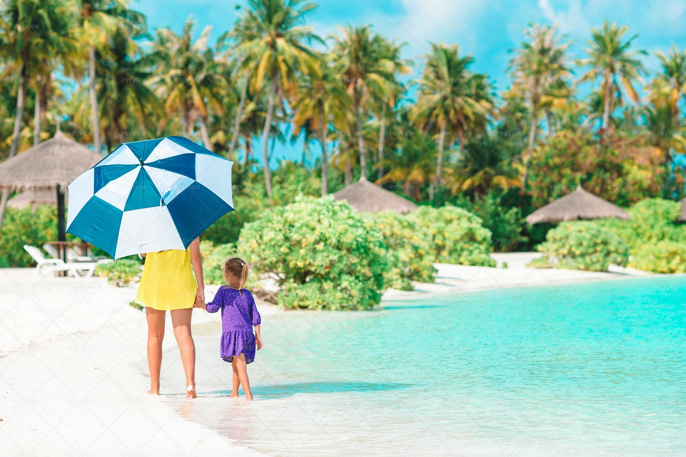 Mom And Kid Walking With An Umbrella: Stock Photos
