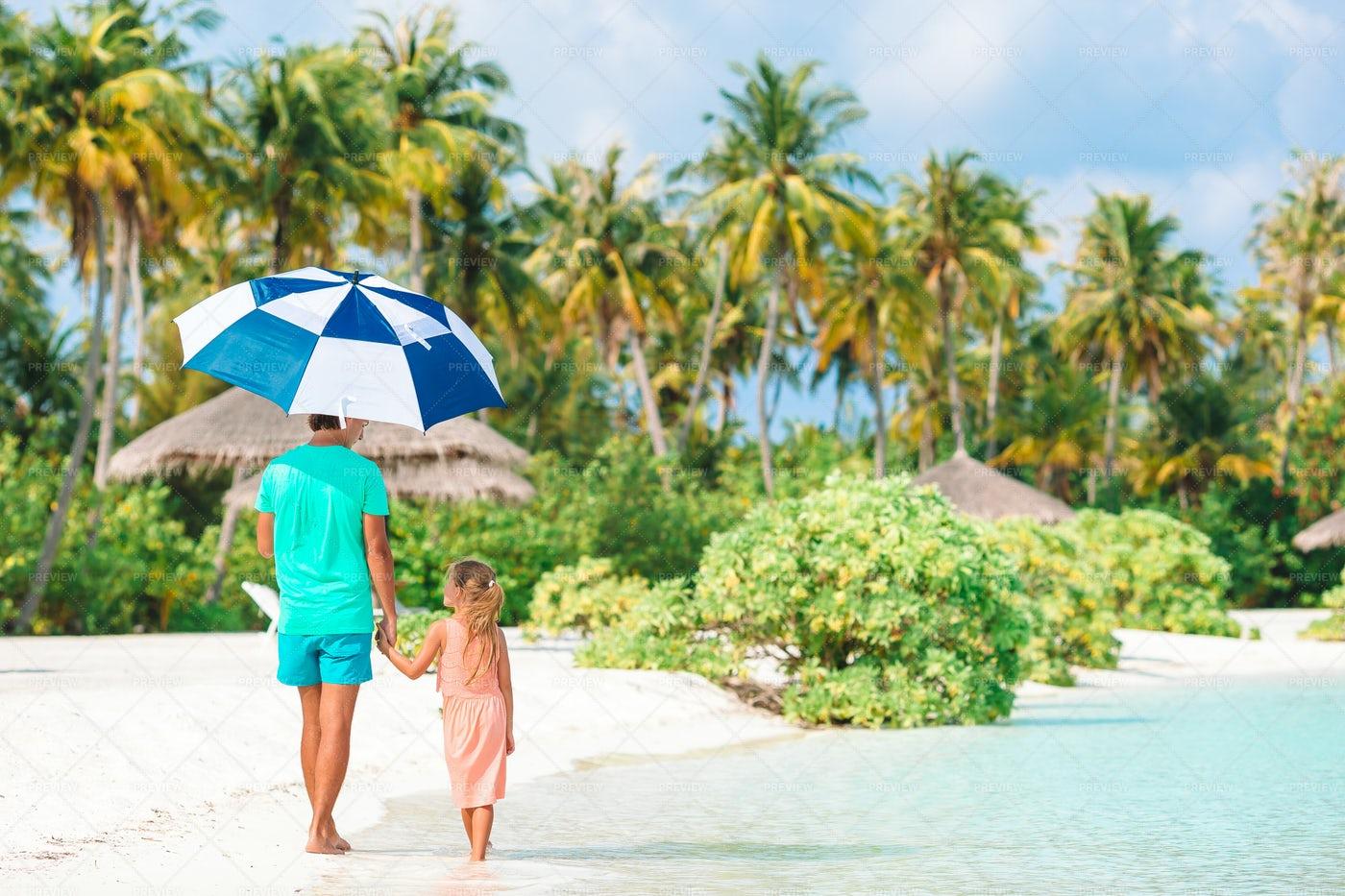 On The Beach With An Umbrella: Stock Photos