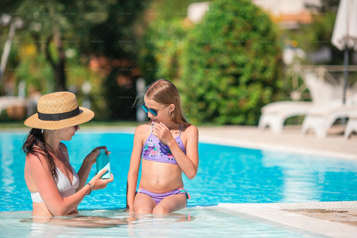 Applying Sun Cream To Daughter: Stock Photos