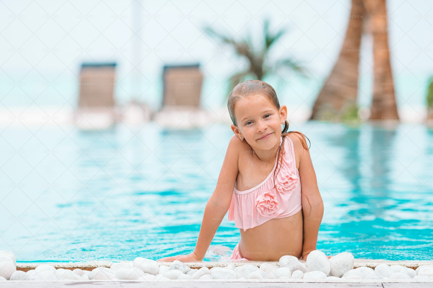 Little Girl In A Swimming Pool: Stock Photos