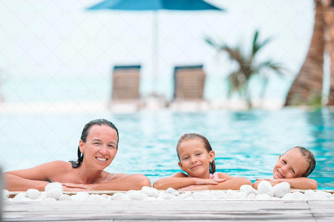 Mother And Daughters At The Pool: Stock Photos