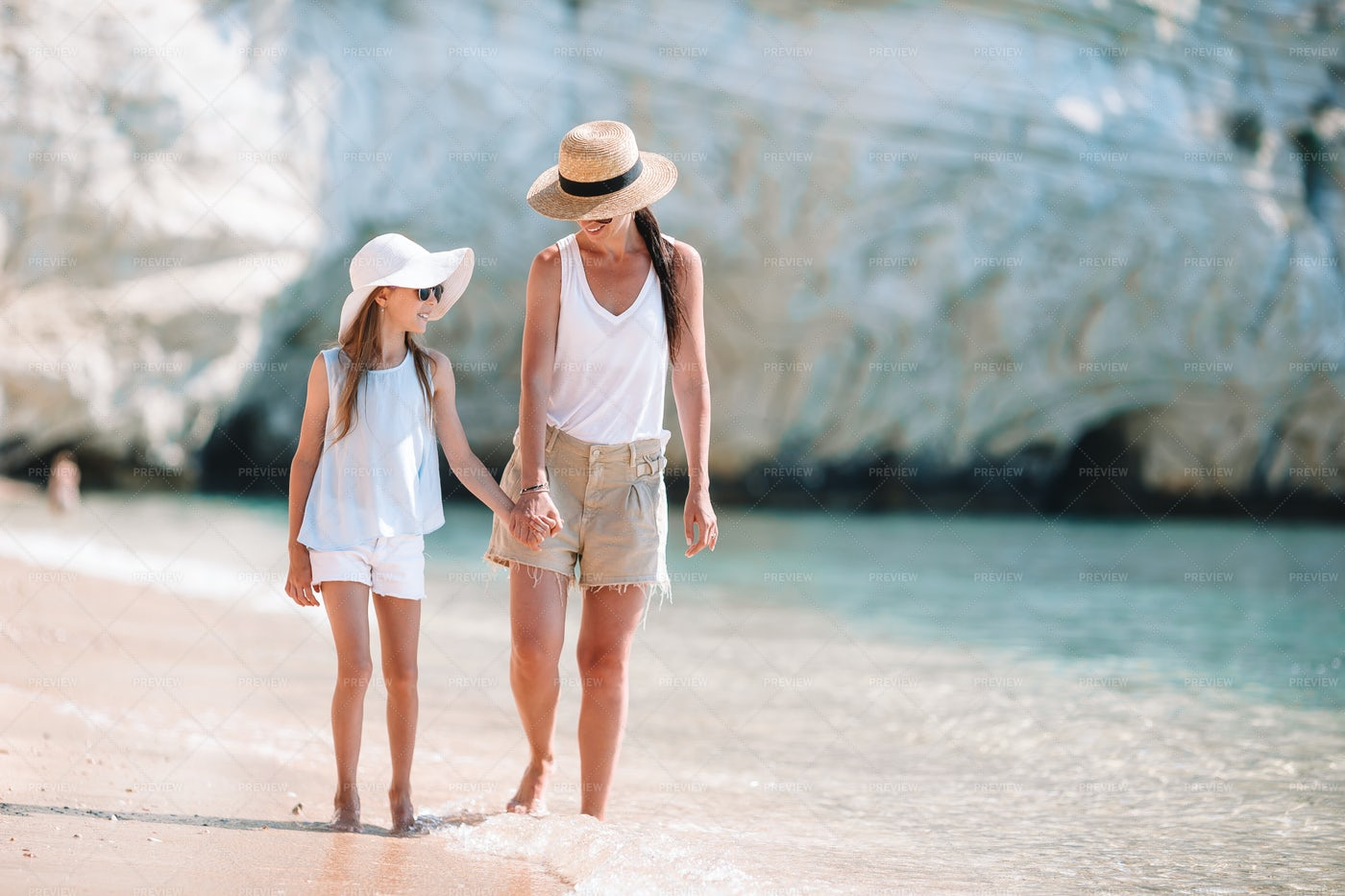 Mother And Daughter Holding Hands: Stock Photos