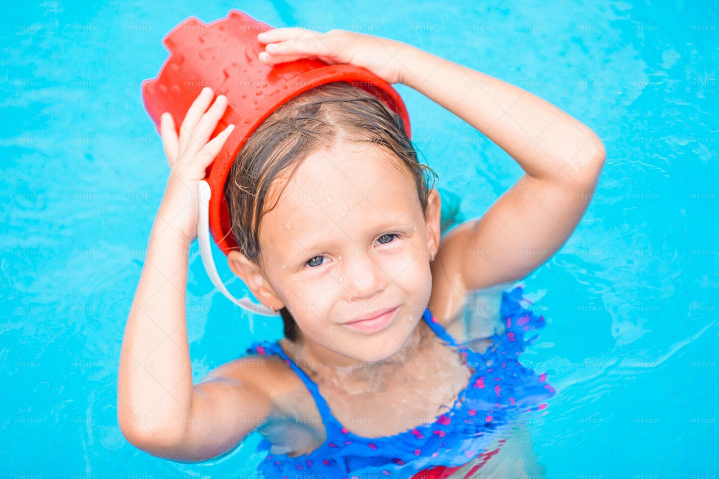 Bucket On Her Head: Stock Photos