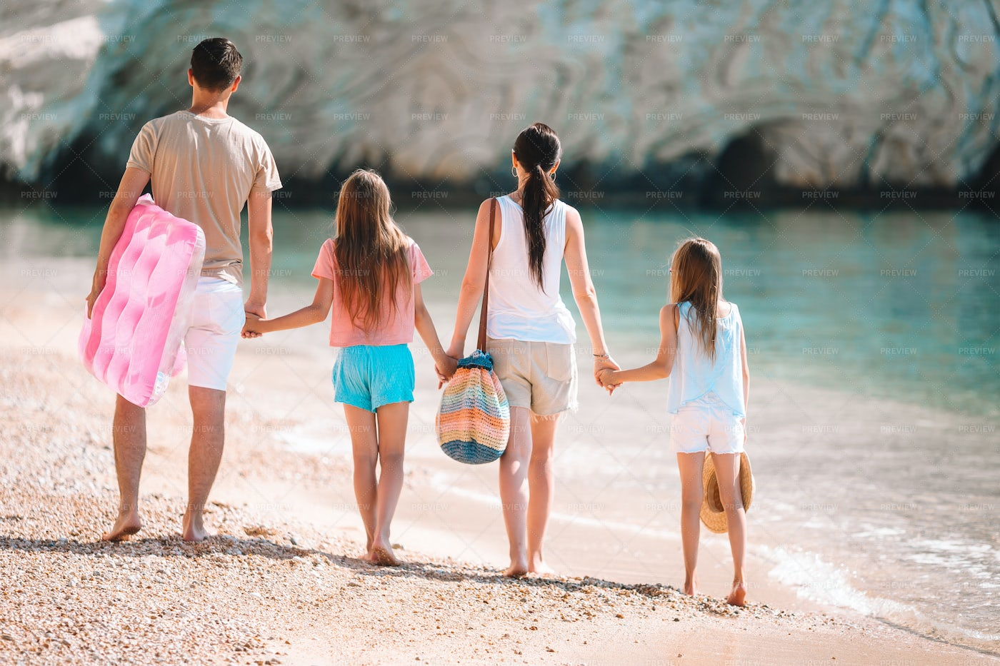 Family Carrying Beach Things: Stock Photos