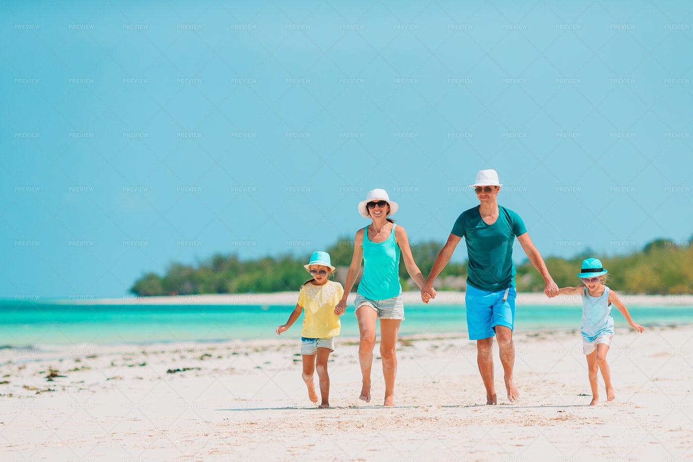 Family Runs On Beach: Stock Photos