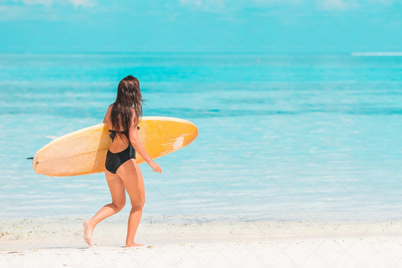 Surfer Woman Running To The Water: Stock Photos