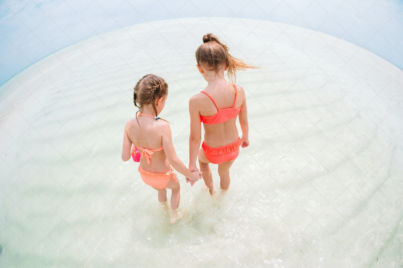Sisters In The Ocean: Stock Photos