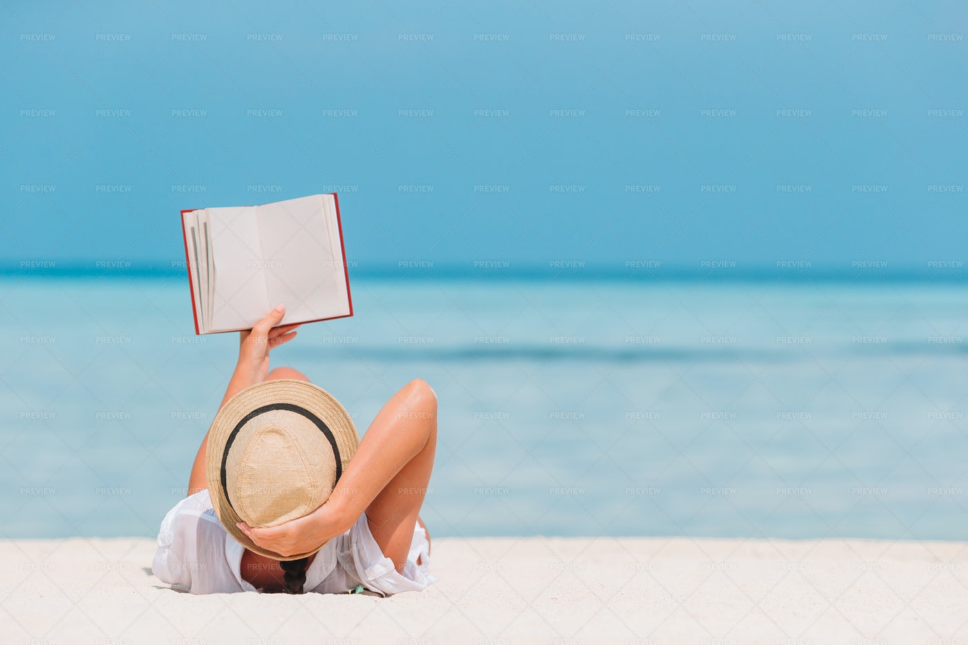 Reads Book By The Shore: Stock Photos