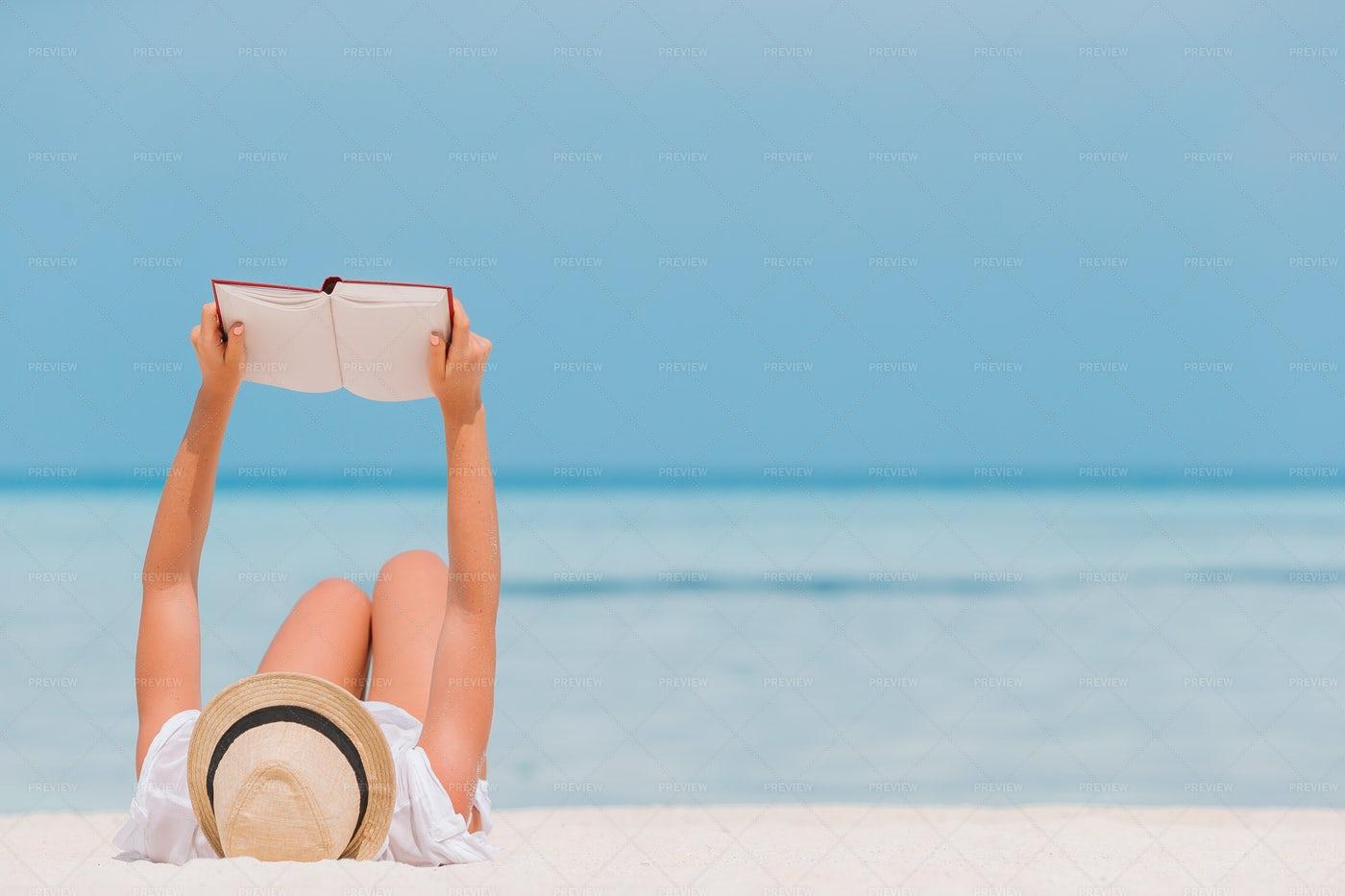 Reading Blank Book On Beach: Stock Photos